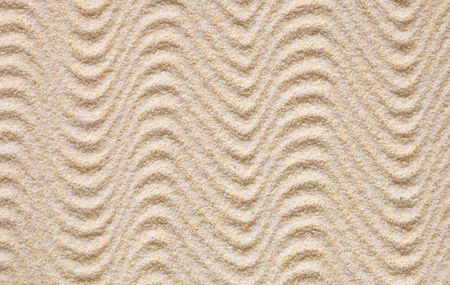 garden waste: Texture from yellow sand covered with waves Stock Photo