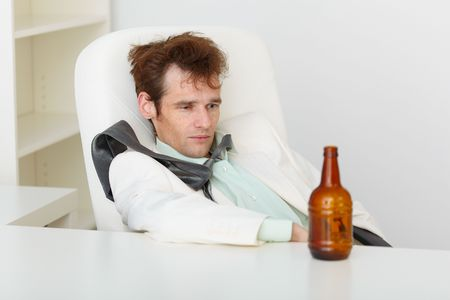 necktie beer: The person sits at a table and suffers from a hang-over