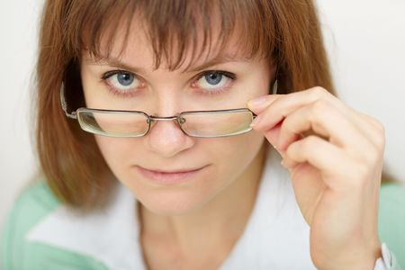 The young woman strictly looks over spectacles photo