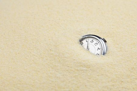 sinks: Ancient mechanical watch sinks in sand symbolize leaving time Stock Photo