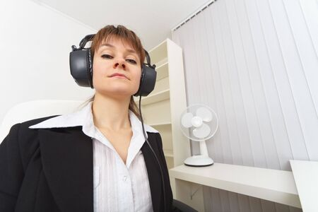The haughty woman the producer with ear-phones on a head Stock Photo - 6095058