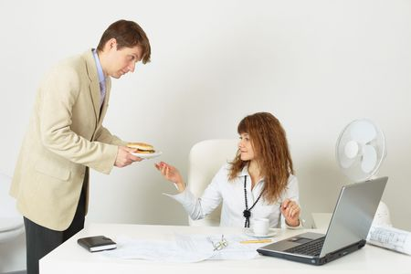 The person gives to the young woman meal on a plate photo