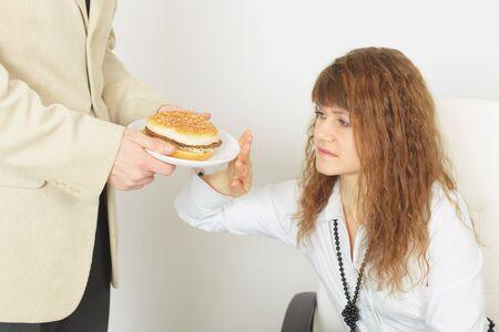 renounce: The young beautiful girl refuses harmful food Stock Photo