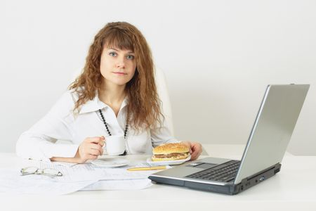 The young woman is going to have dinner a hamburger at office photo