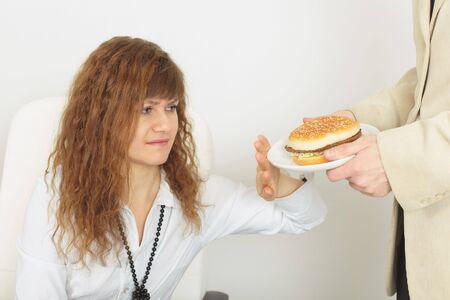 renounce: The young beautiful woman refuses harmful food
