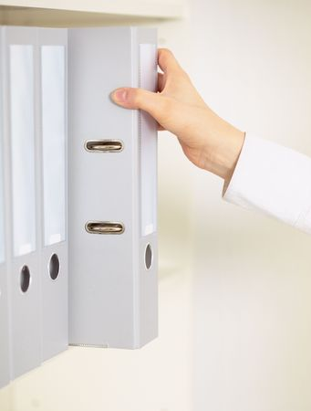 archival: Folder with archival documents and a hand of the clerk Stock Photo