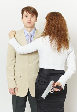 Pair of young men - the woman with a pistol and the man photo