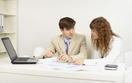 bussines people: Pair of young businessmen on a workplace in office Stock Photo