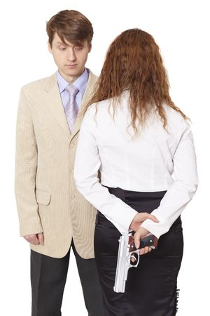 The young man and the woman armed with a pistol isolated on white photo