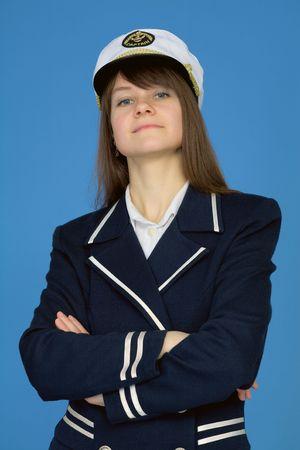 supercilious: Portrait of the proud woman - the sea captain on blue Stock Photo