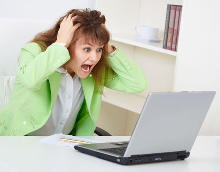 enraged: The enraged woman reads news in the Internet Stock Photo