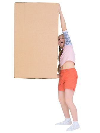 The small cheerful girl drags the big cardboard box isolated on white photo