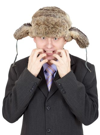 russian man: Emotional comical Russian man in a fur hat and coat on a white background