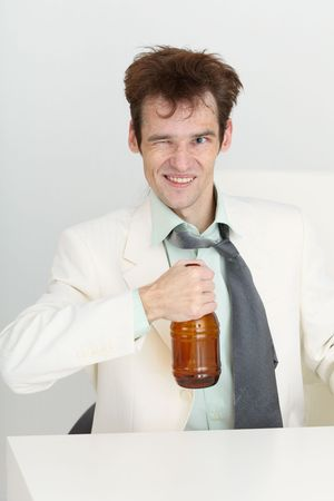 necktie beer: Cheerful guy in a white jacket with a bottle of beer in his hand