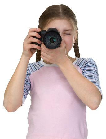 Little girl with a camera isolated on a white background photo