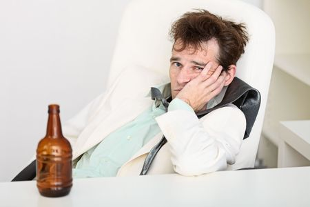necktie beer: The guy is suffering from a hangover because beer is gone