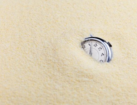 Composition on Zen garden - yellow sand, and old watch