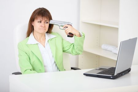 Girl shoots himself in the head while sitting in the office - an attempt to commit suicide Stock Photo - 6354158