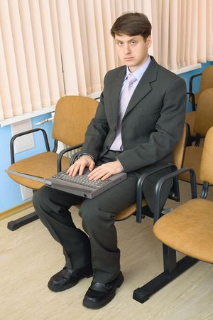 The person in a suit with the laptop in a lap Stock Photo - 6354011