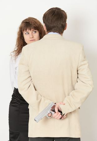 woman with gun: A young man and a beautiful woman. gun in hand Stock Photo