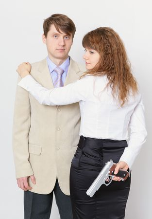 A young man and a beautiful woman with gun in hand photo