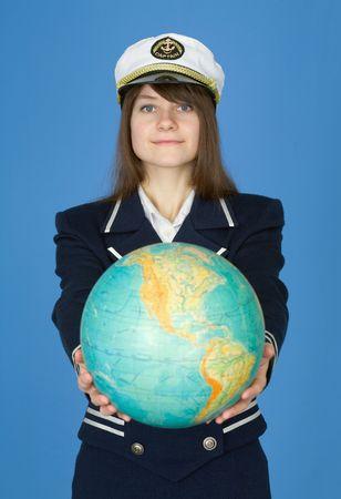 terrestrial globe: Girl in sea uniform with terrestrial globe