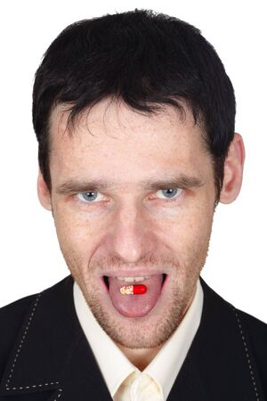 A young man eats a pill put it on the tongue Stock Photo - 6375665