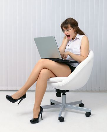bawl: The frightened woman looks at a computer screen Stock Photo