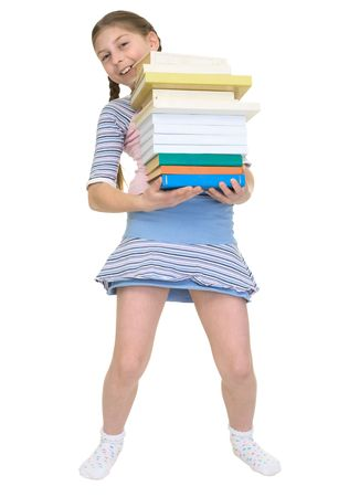 The schoolgirl has a large stack of textbooks photo