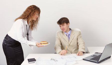 She treats colleague sandwich in the office photo