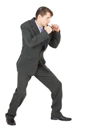 A man in a combat stance, isolated on a white background Stock Photo - 6436228