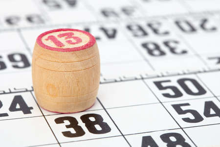 Wooden barrel lotto with a red number thirteen photo