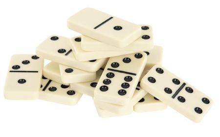 dominoes: A large pile of dominoes isolated on a white background