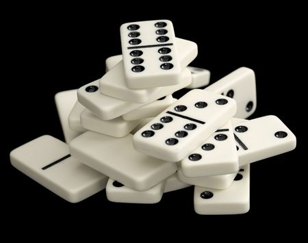 rickety: A large heap of dominoes isolated on a black background