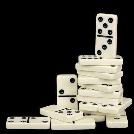 rickety: A large pile of dominoes isolated on a black background