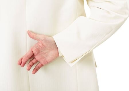 Businessman in white suit with crossed fingers behind his back Stock Photo - 6436349