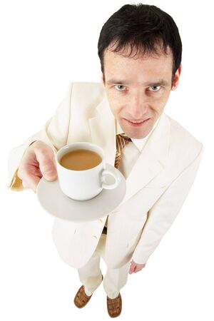 Funny man in a light suit offers a cup of coffee photo