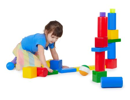 Girl playing toy bricks on white background Stock Photo - 6470893