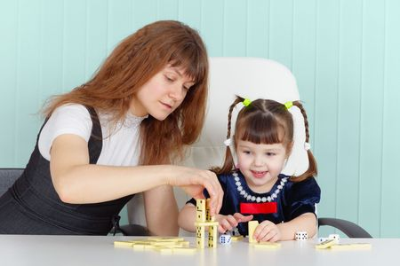 Mother and daughter play together at the table Stock Photo - 6470923