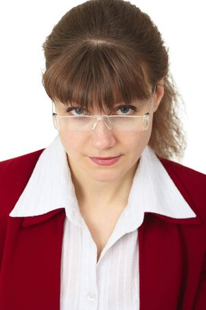 Young woman looking over her spectacles on white photo
