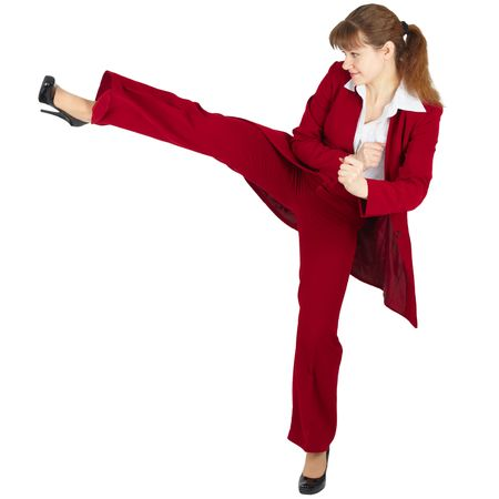 Beautiful girl in business suit kicks, isolated on a white background Stock Photo - 6470961