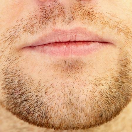 Mens short beard and lips close up photo