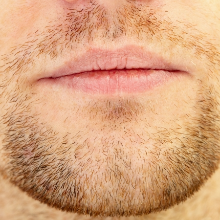 straggly: Mens short beard and lips close up