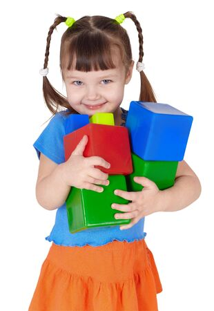 Little happy girl with toys in the hands on white Stock Photo - 6470975