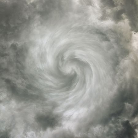 Twisting spiral dark sky with storm clouds photo
