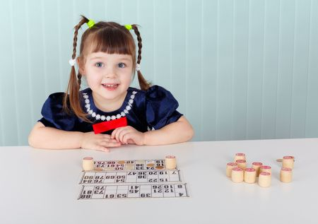 played: A child sitting at a table and played with bingo