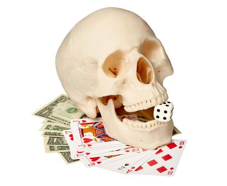 bared teeth: Human skull, playing cards and money on a white background Stock Photo