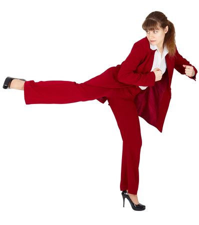 Young woman in a business suit kicks back photo