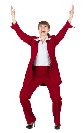 exultation: Jubilant young woman in a red business suit