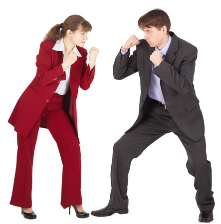 Man and woman in business suits are going to fight on white background photo